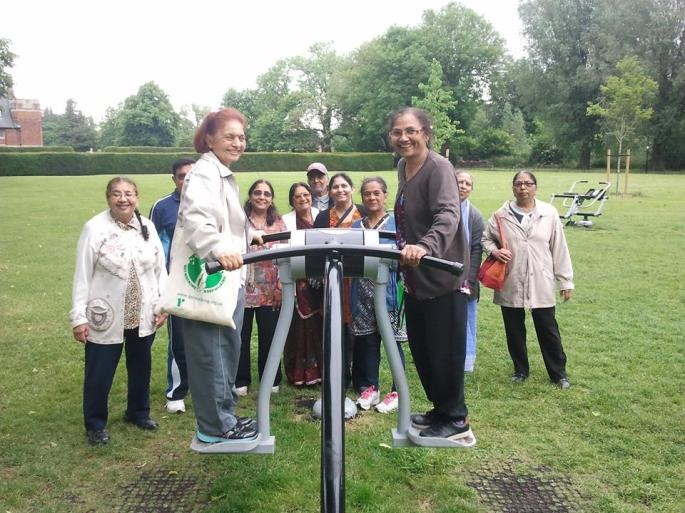 Group taking part on an outdoor gym in a guided walk lead by Living Streets